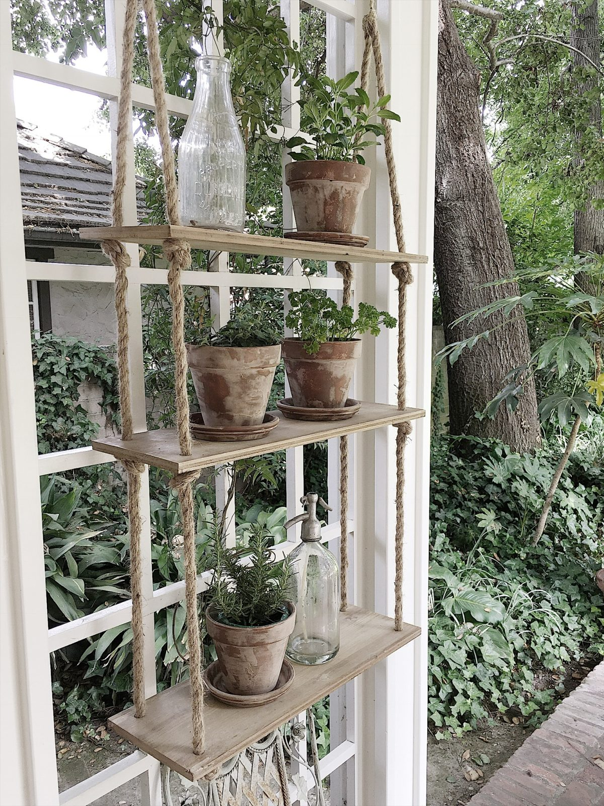 Aged terracotta pots on floating rope shelves by My 100 Year Old Home. Easy DIY Home Tutorials & Inspirational Quotes.