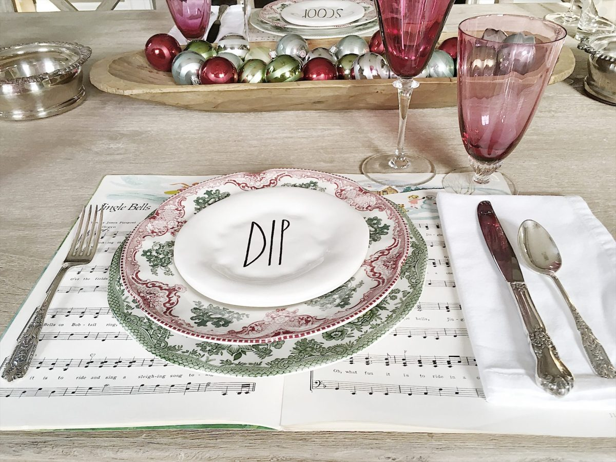 holiday table with music and cranberry glass