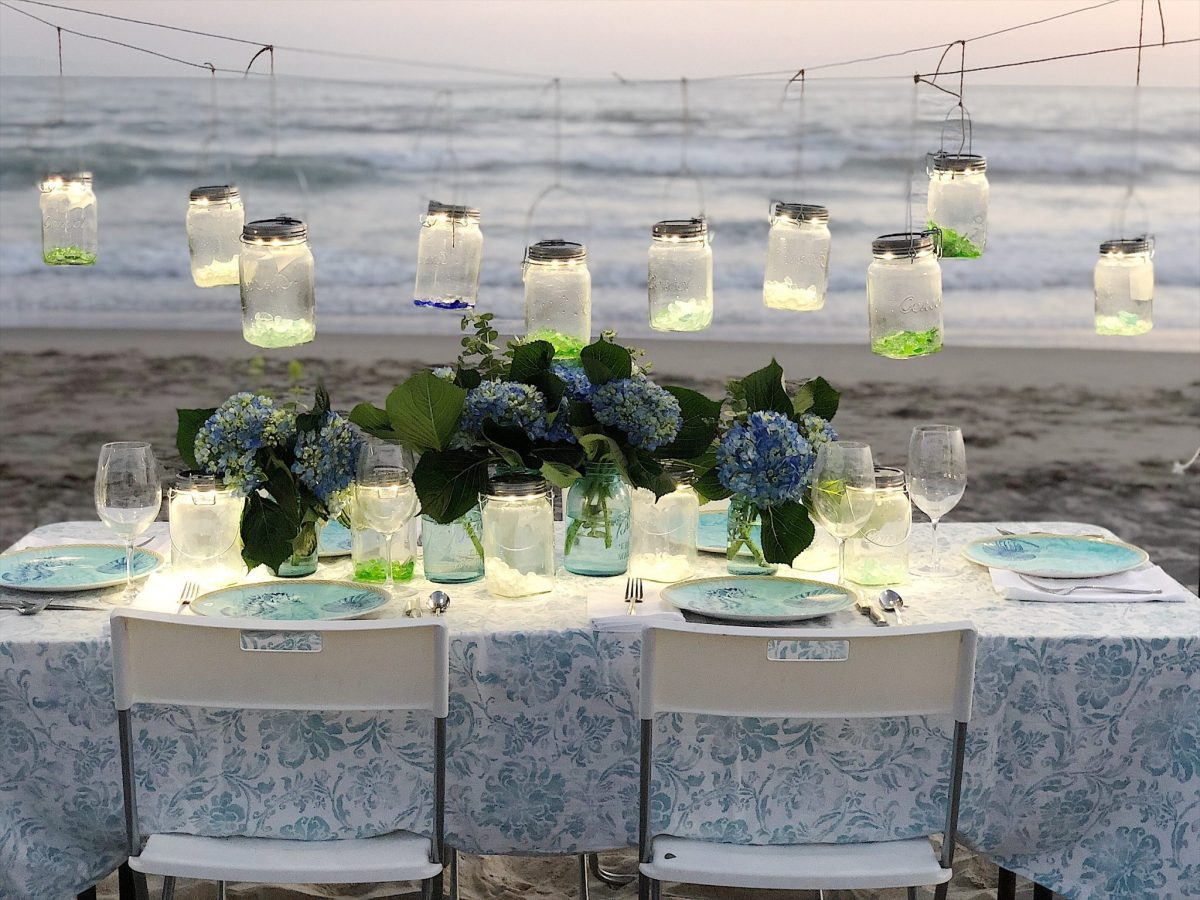 setting a table at the beach