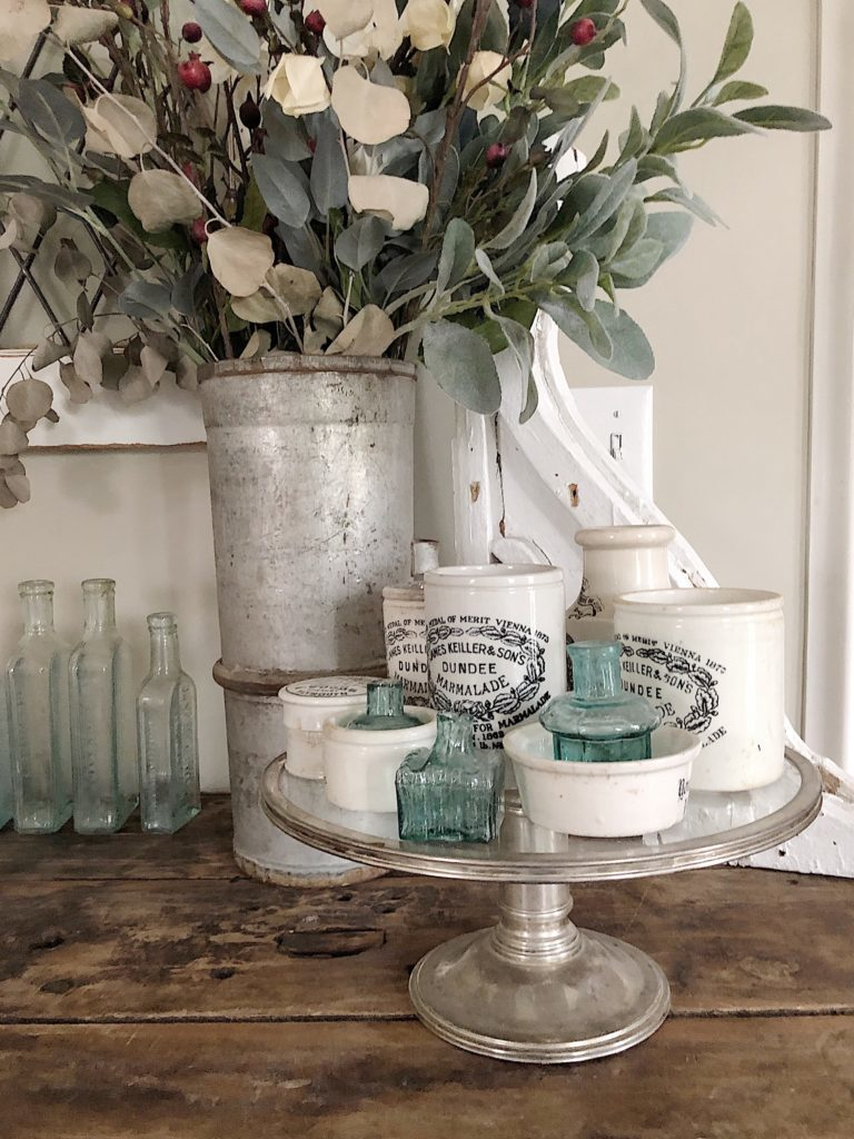 vintage glass cake stands with advertising pots