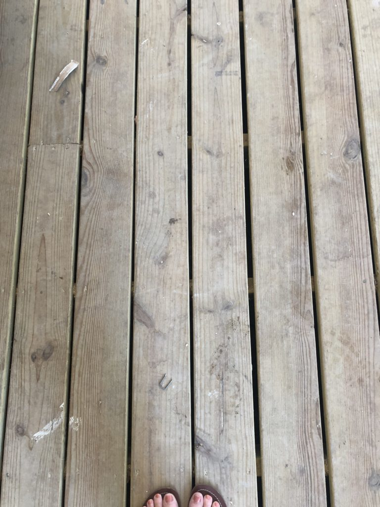 Non-painted porch floorboards after the rain