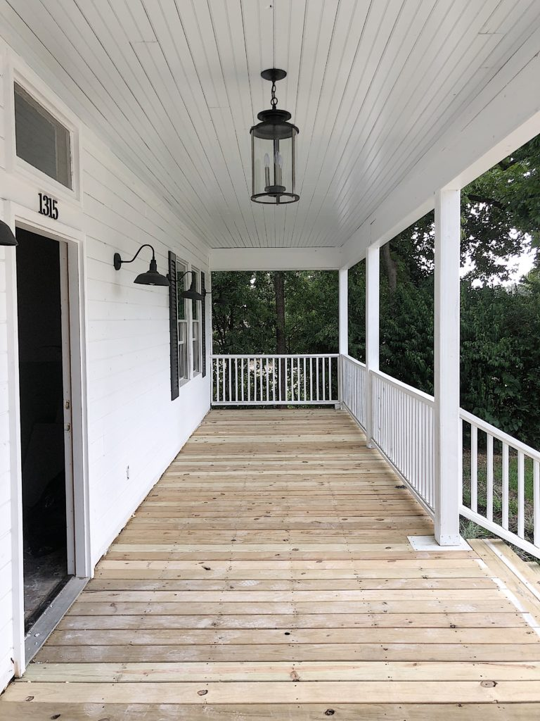 The front porch with unpainted floor boards