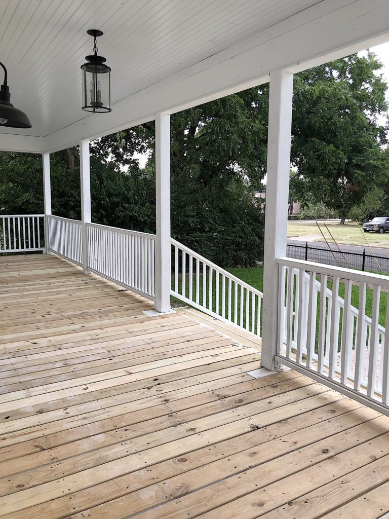 front porch with unpainted floor boards