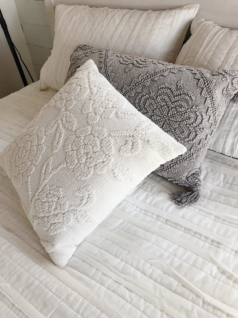 grey and white throw pillows