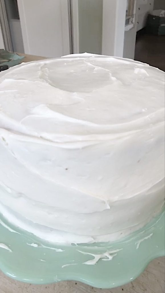 icing a coconut cake