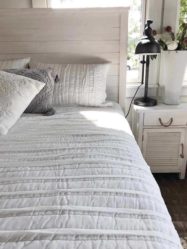 white washed wooden bed