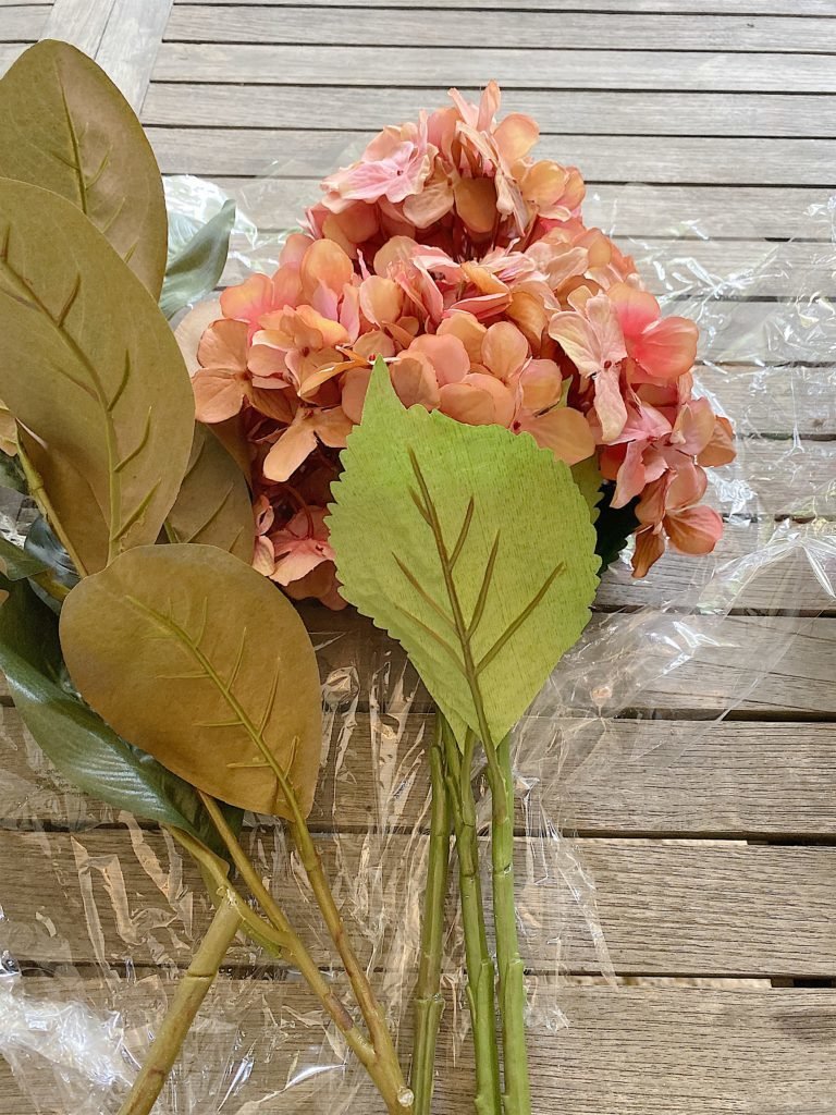 faux hydrangeas and magnolia leaves