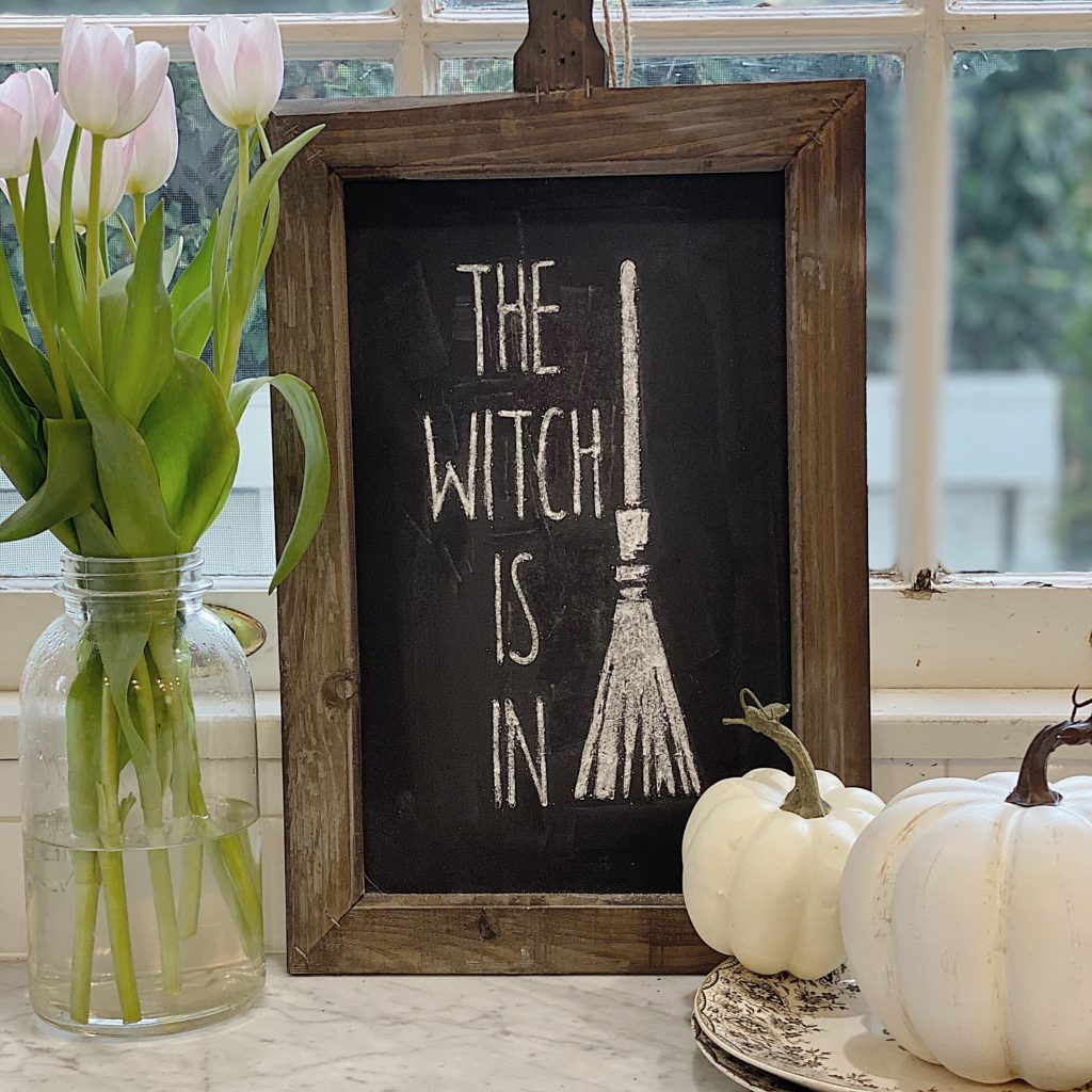 "This adorable Halloween chalkboard says ""The Witch Is in"""