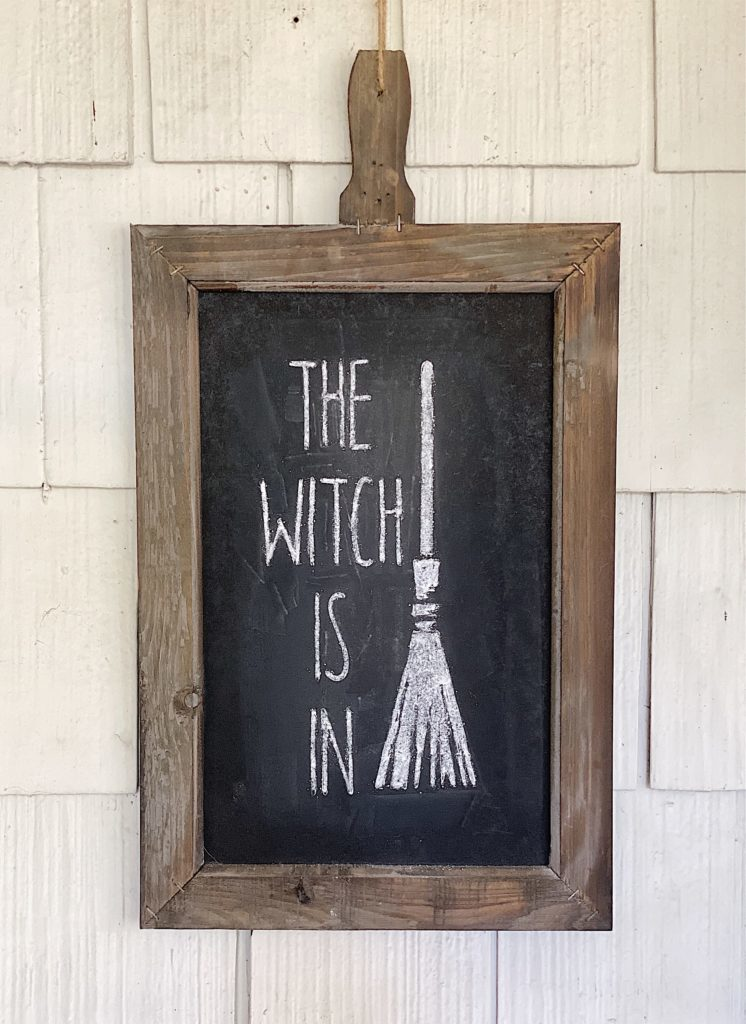 I hung the Halloween chalkboard outside by the door.