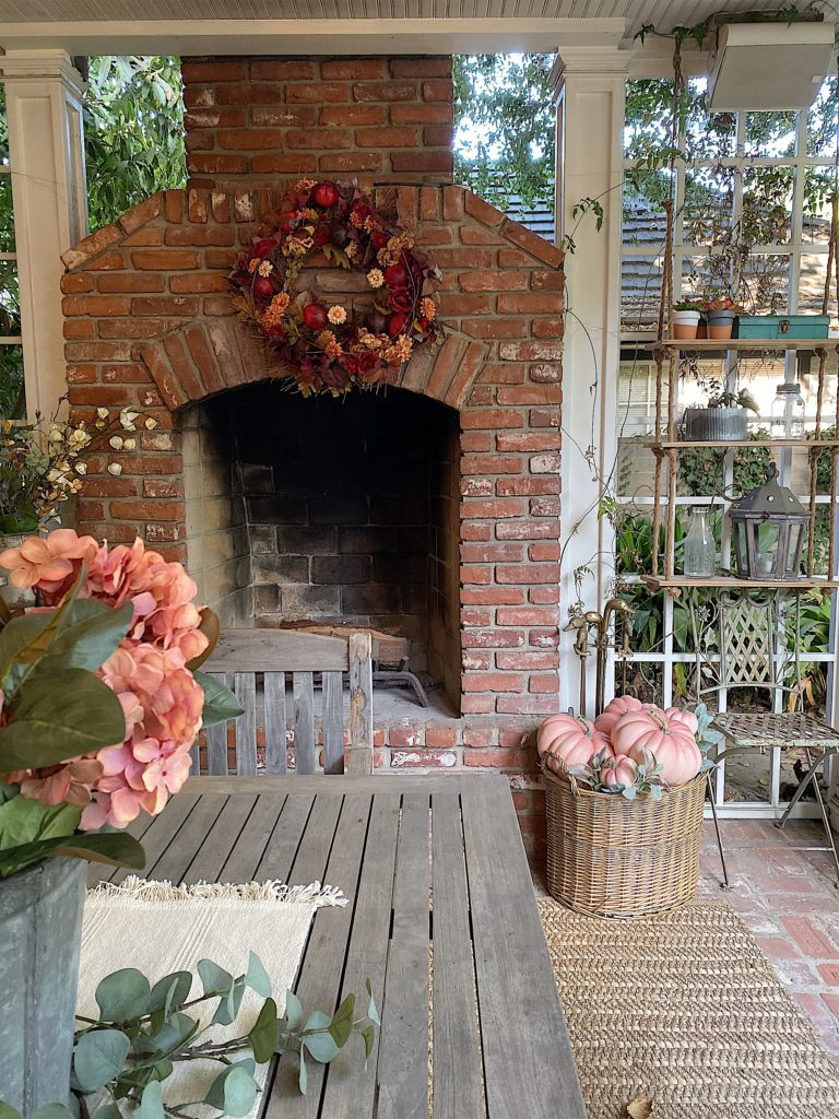 Blush and pink fall decor on back porch