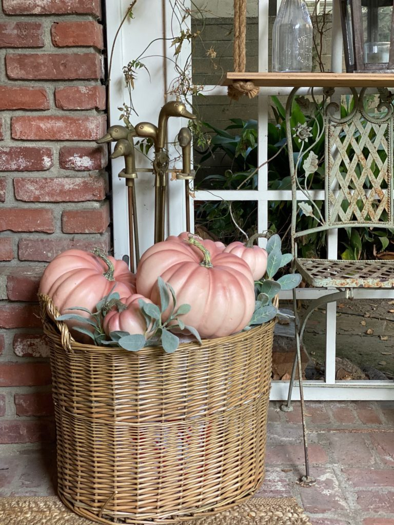 Faux pumpkins in flea market basket