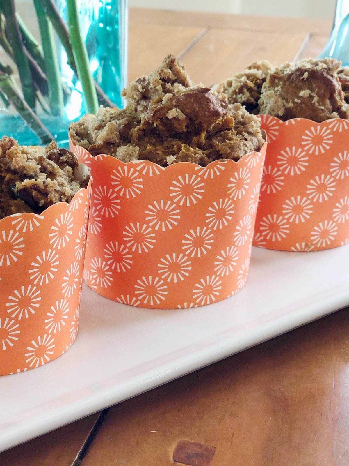 These pumpkin muffins with streusel toppings are delicious. They look adorable in these orange muffin cups.