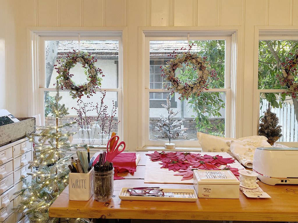 frosted berry wreaths in the windows