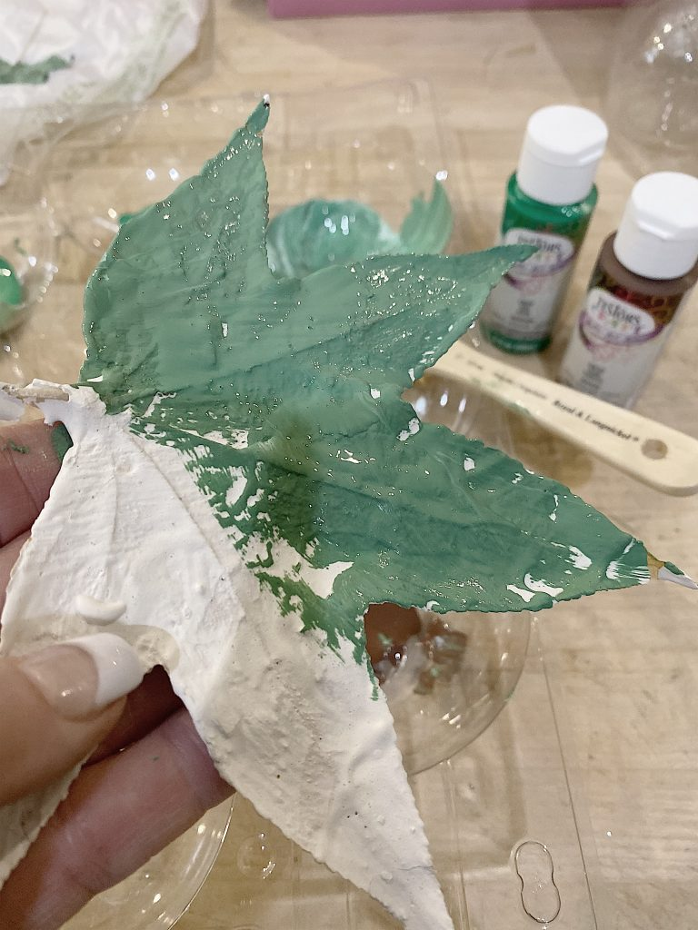 painting plaster leaves with paint