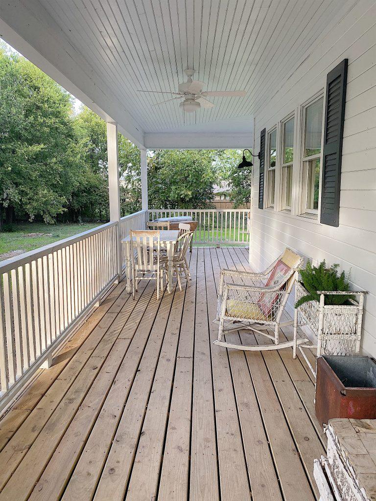 wrap around porch in the waco fixer upper home