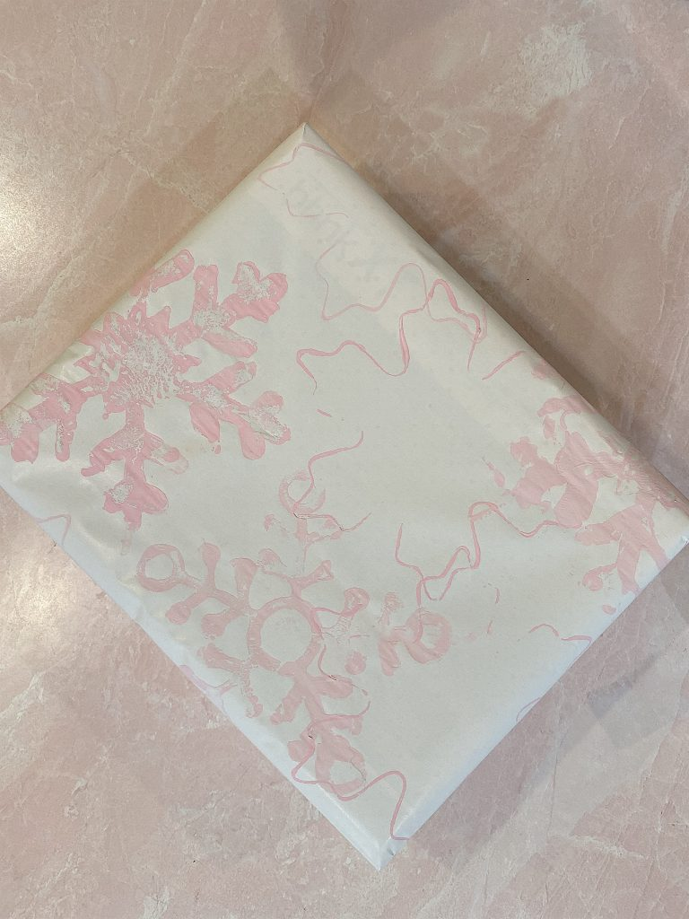 pink snowflake wrapping paper