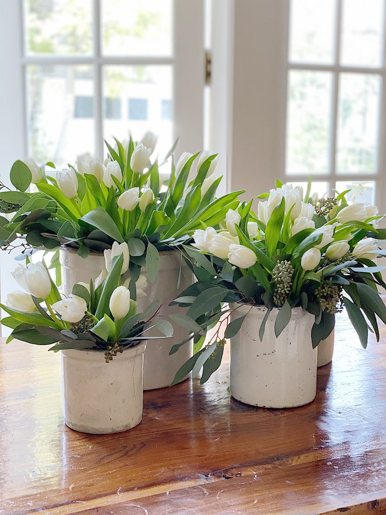 five crocks with vintage tulips