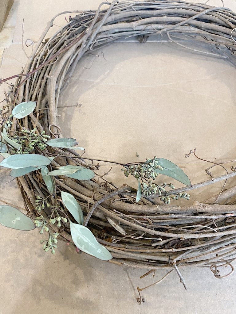 adding eucalyptus to wreath