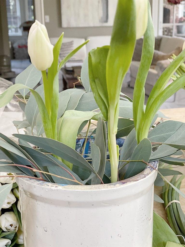 tulips in vintage crocks