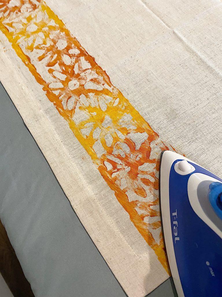 Ironing the Napkin to Set the Acrylic Paint