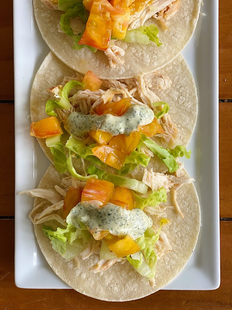 Crock Pot Chicken Tacos with Cilantro Cream Sauce