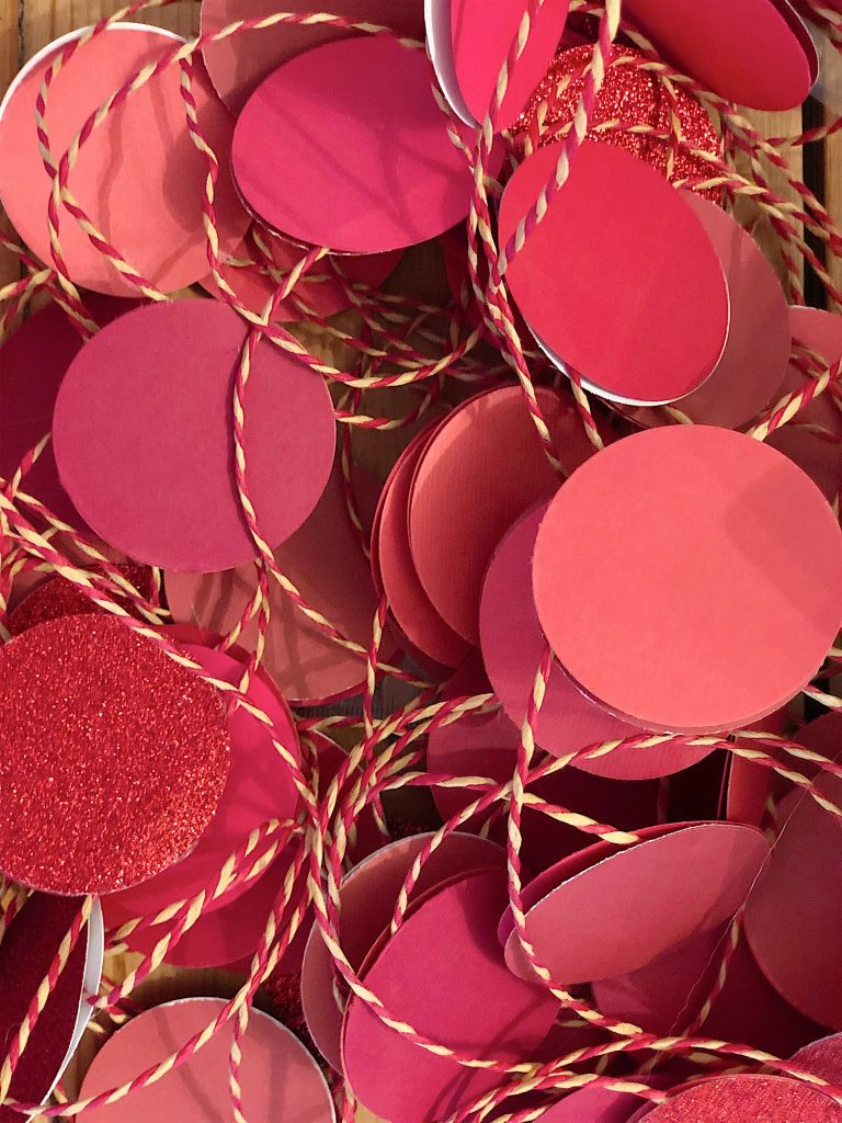 decorated-christmas-trees-red-paper-garland