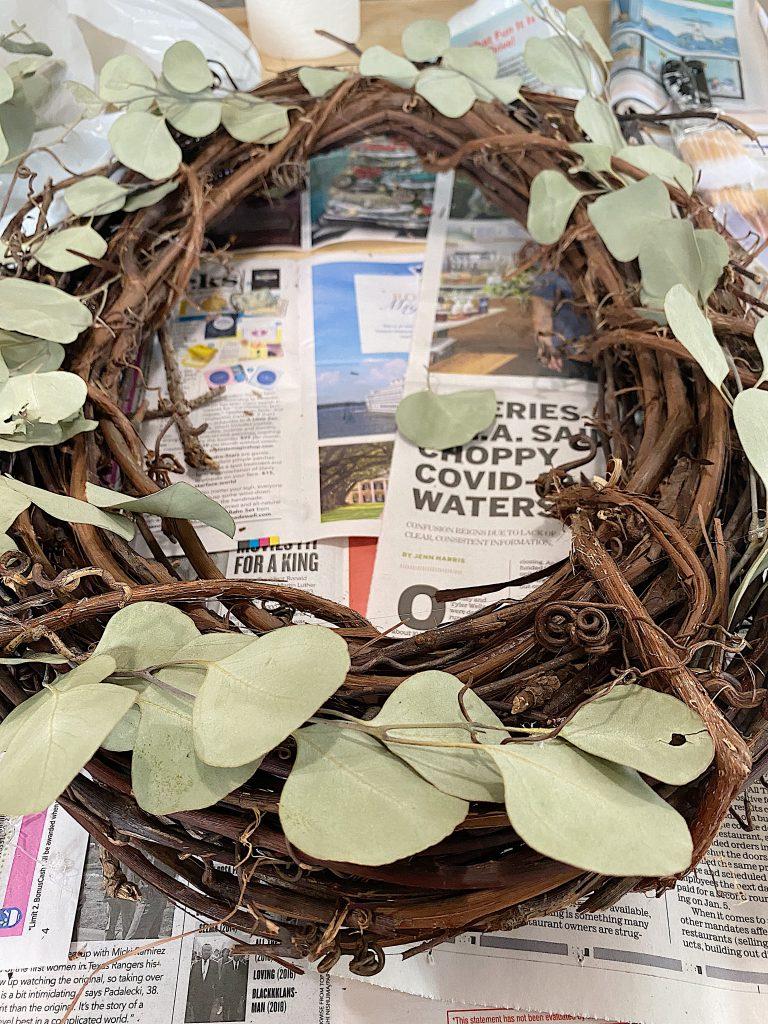 Pine Cone Wreath DIY Adding Dried Eucalyptus