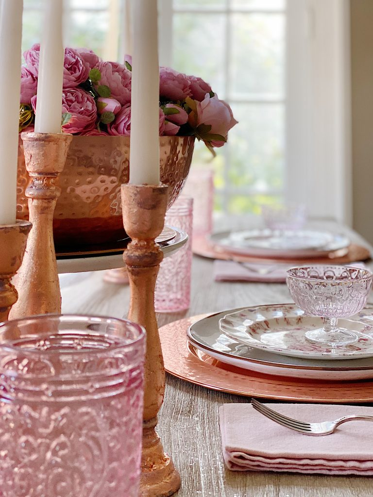 Rose Gold Candlesticks on the Table