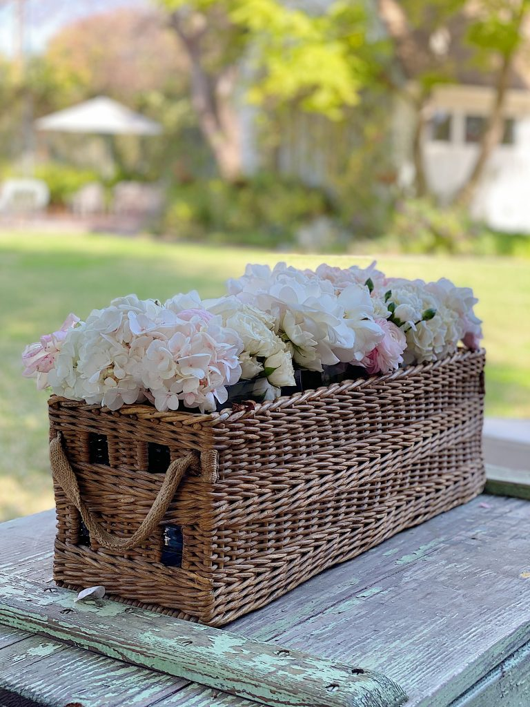 Fresh Flowers in a Basket Outside