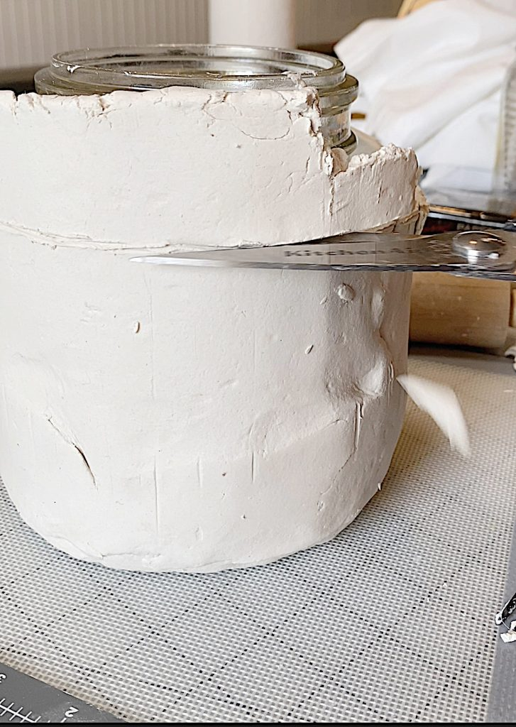 Cutting the top of the Paper clay Pot