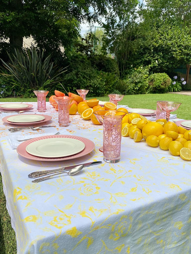 I love how I rescued this stained tablecloth by painting it in summer colors with a paint roller. It looks perfect on my Summer Colors Citrus Table!