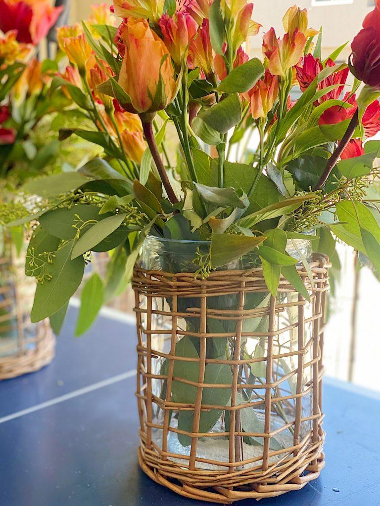 Arranging Flowers in vases for Summer Beach Dinner
