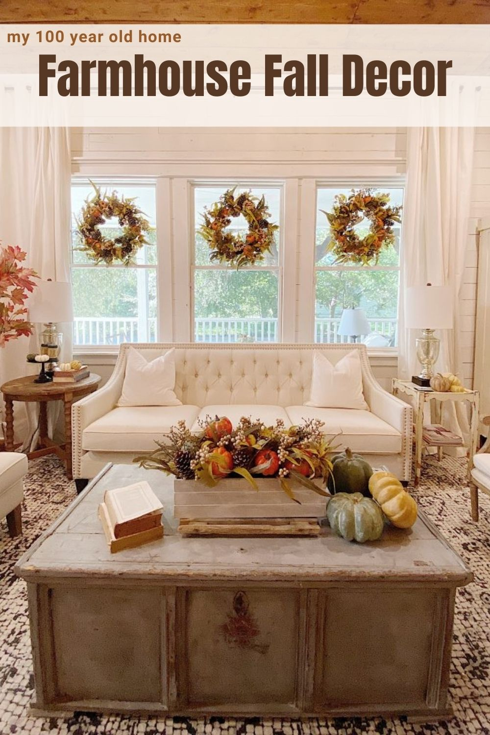 I love adding fall farmhouse decor colors to our living room. The wreaths, tree, arrangement, and pumpkins are perfect for our Waco home.